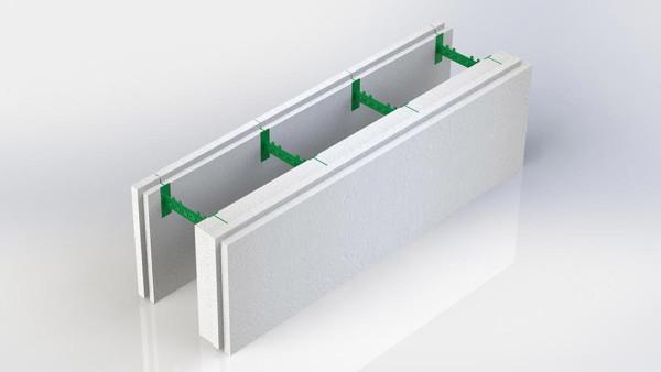 На фото разборной термоблок состоящий из двух пенопластовых панелей толщиной 100 мм и 50 мм и семи пластиковых регулируемых перемычек позволяющих регулировать толщину бетонного ядра стены в диапазоне от 100 до 450 мм.